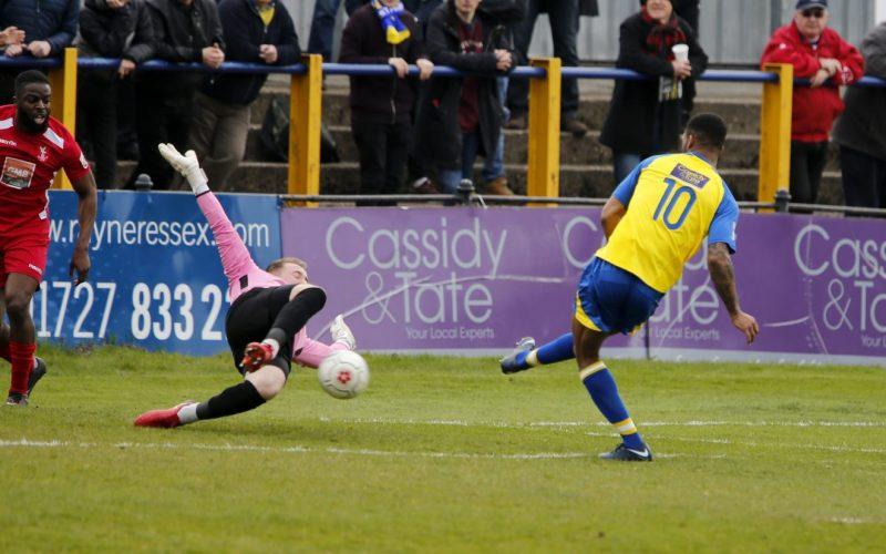 Kieran Monlouis is unable to get the ball past Dan Wilks